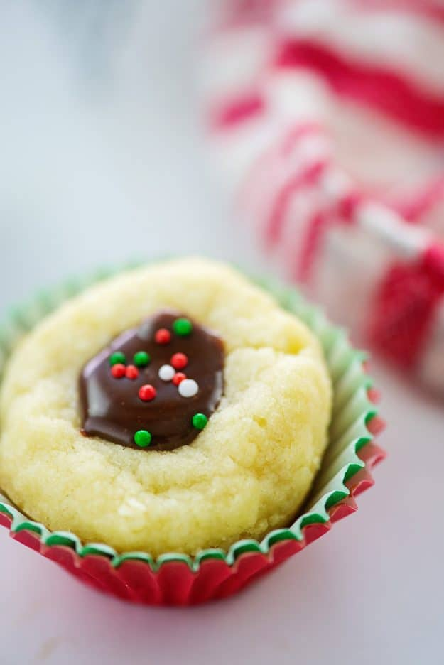 thumbprint cookie in Christmas paper.