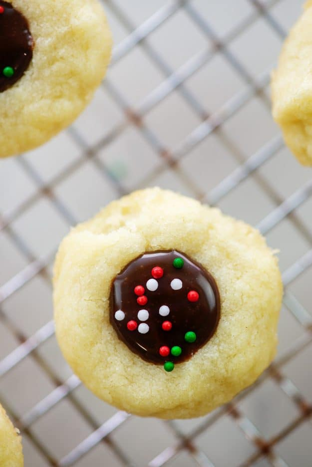 chocolate thumbprint cookie topped with Christmas sprinkles.