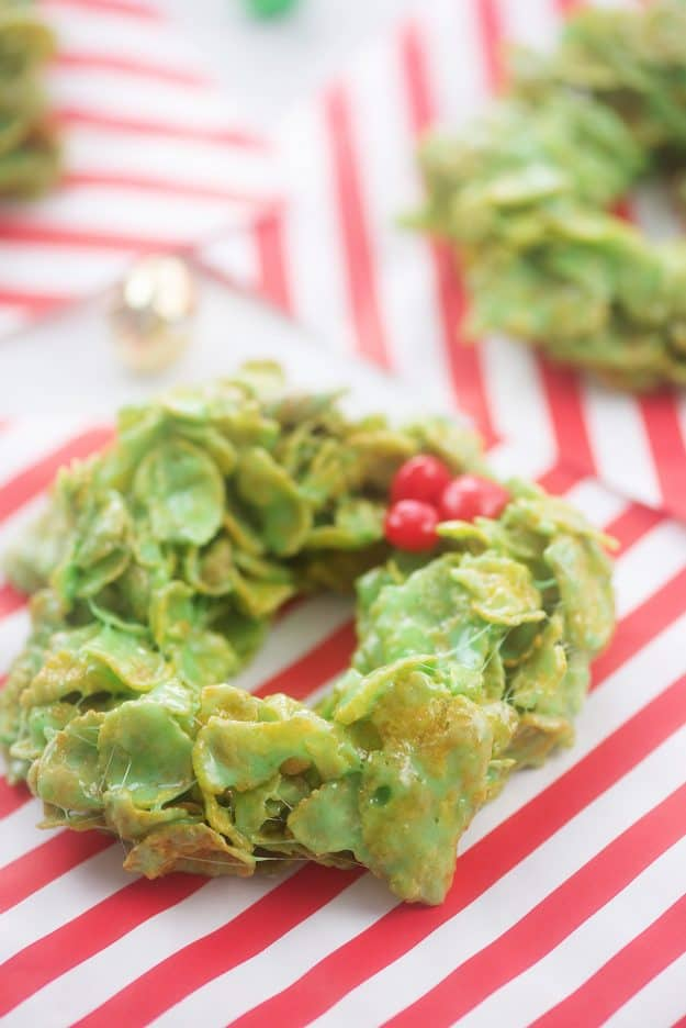 no bake wreath cookies on red and white paper.