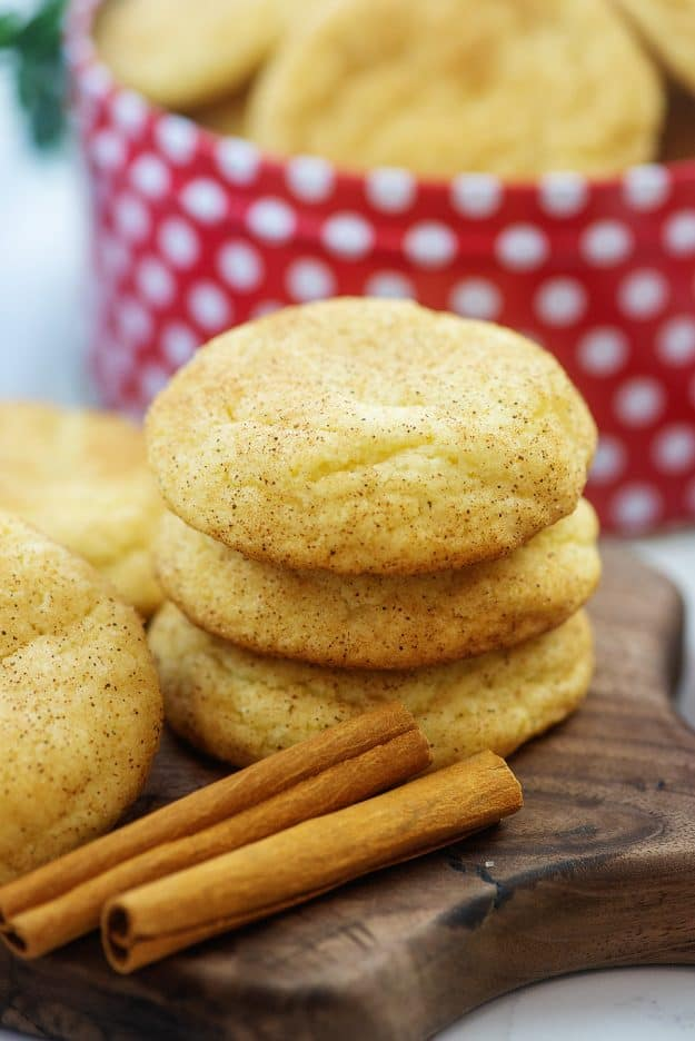 stack of thick snickerdoodle cookies on wooden board.
