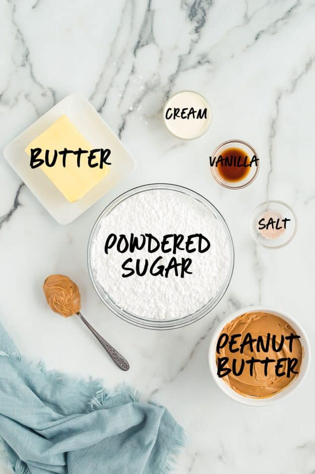 ingredients for easy peanut butter fudge in bowls on white countertop.