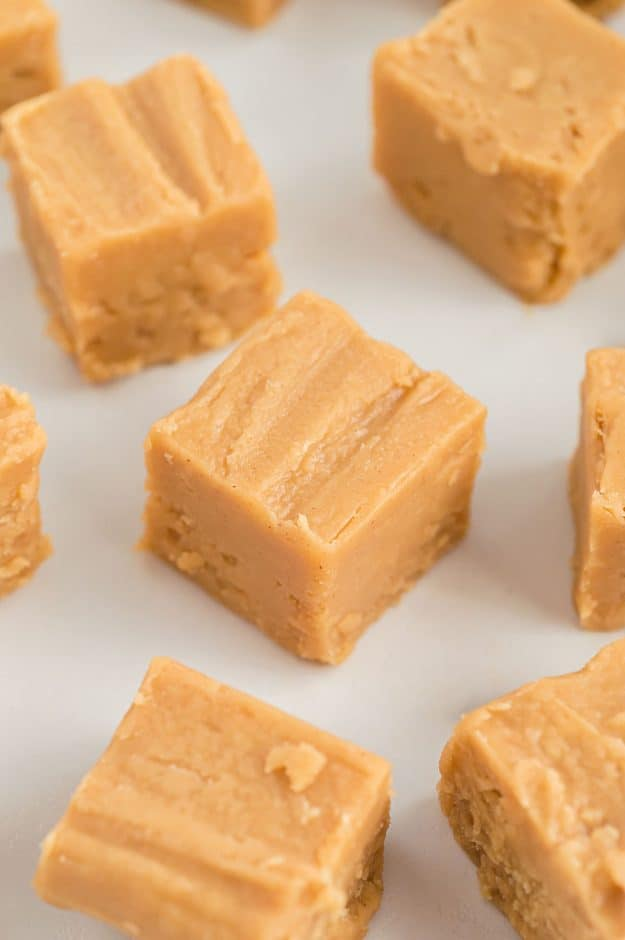 smooth and creamy peanut butter fudge on white countertop.