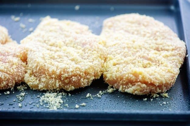 breaded chicken on sheet pan.