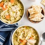 overhead view of chicken noodle soup in bowls.