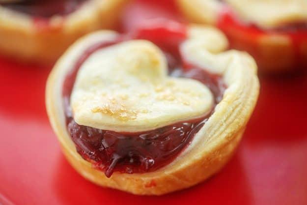 mini cherry pie on red plate.