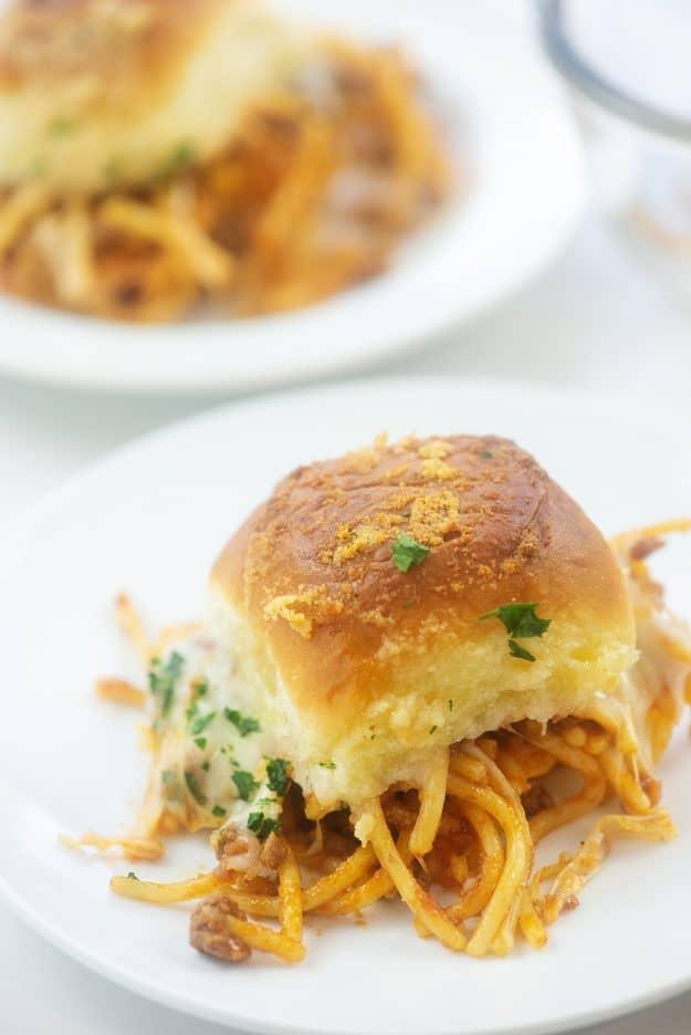 Spaghetti sandwich on white plate.