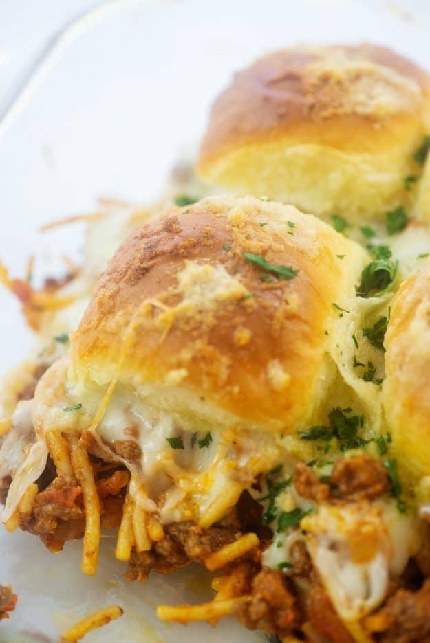 cheesy spaghetti sandwiches in glass baking dish.