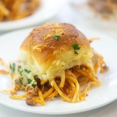 spaghetti sliders on white plates.