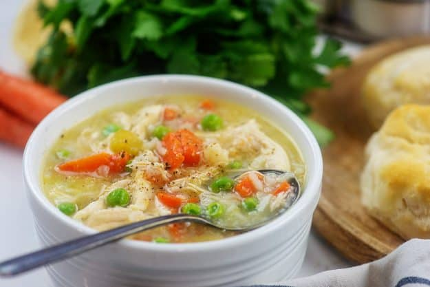 crockpot chicken and rice soup in white bowl.
