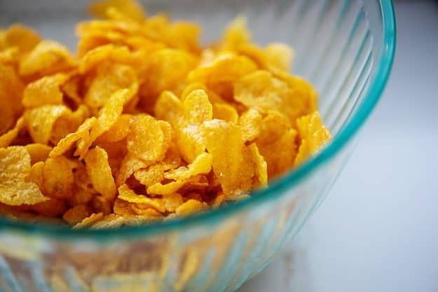 cornflakes in glass mixing bowl.