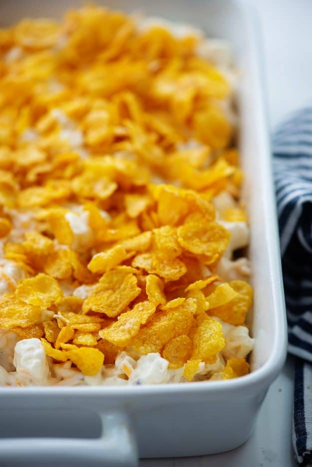 funeral potatoes recipe topped with cornflakes.