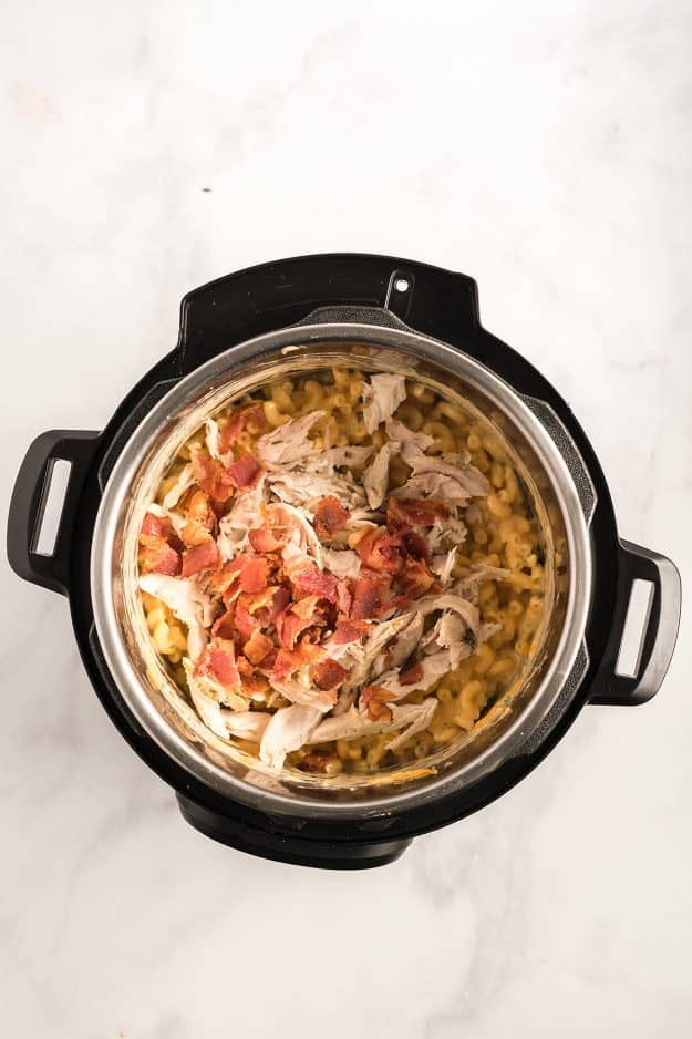 chicken and bacon in pressure cooker with macaroni and cheese.