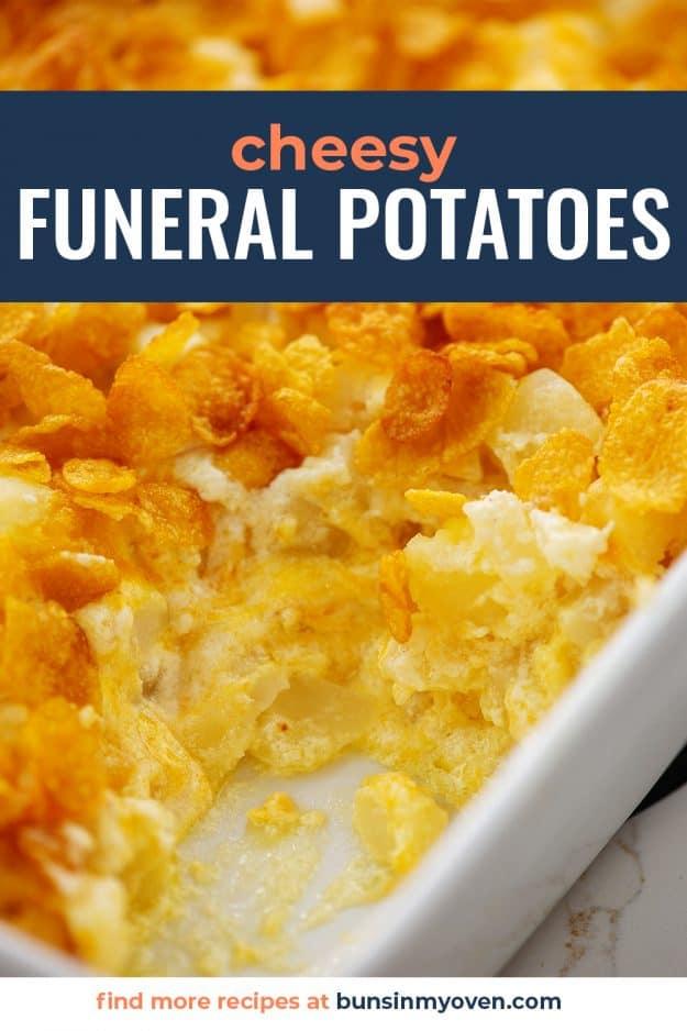 cheesy potato casserole in white baking dish.