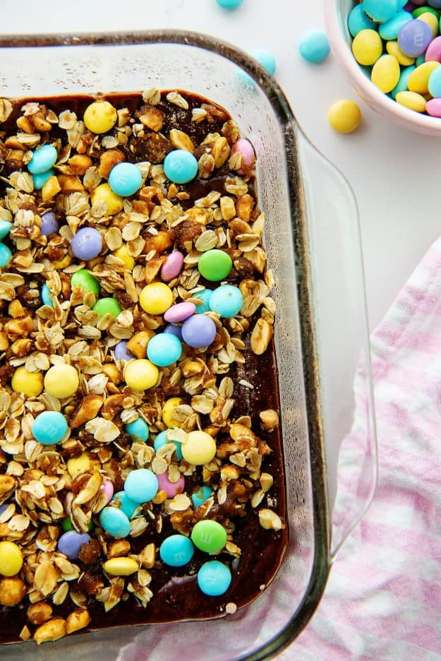 oatmeal and candy topped brownies in glass baking dish.