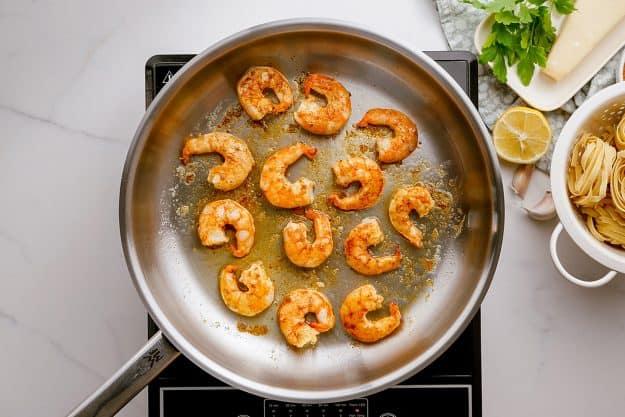 cooked shrimp in skillet.