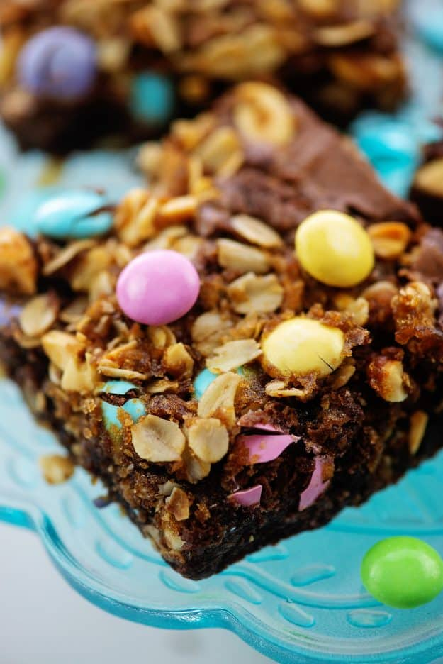Easter Oatmeal Brownies on blue cake stand.