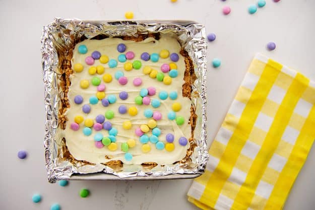 overhead view of Easter peanut butter bars in foil lined pan.