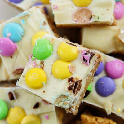 Pile of Easter no bake peanut butter bars.