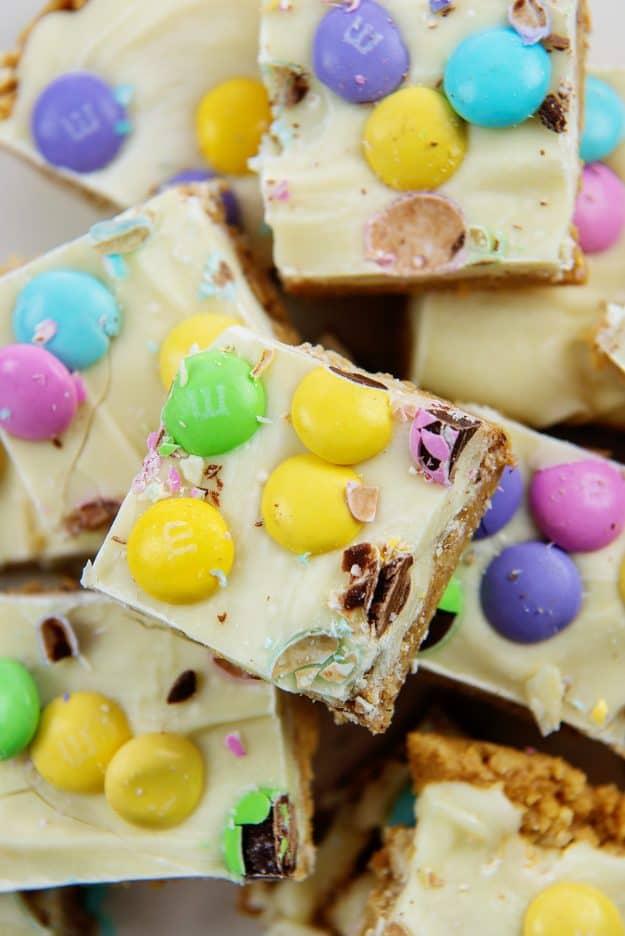 Pile of Easter no bake peanut butter bars.