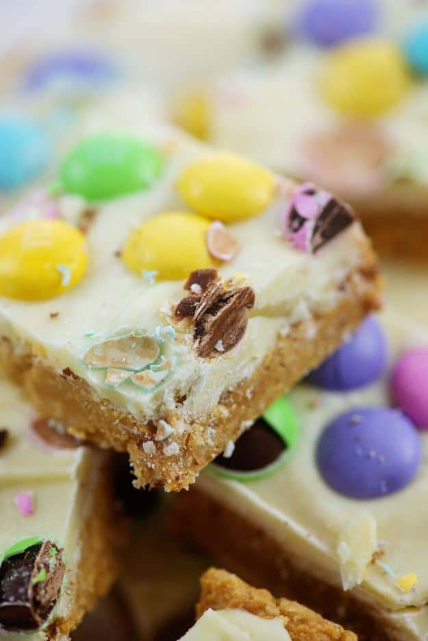 pile of no bake bars topped with Easter candy.