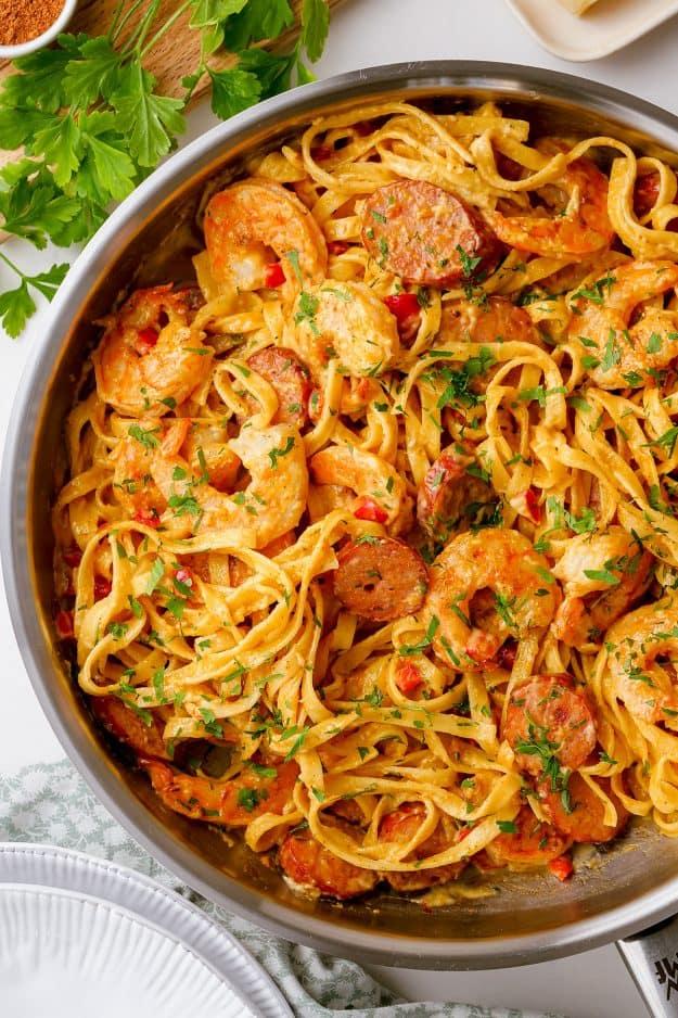 overhead view of cajun shrimp pasta in skillet.