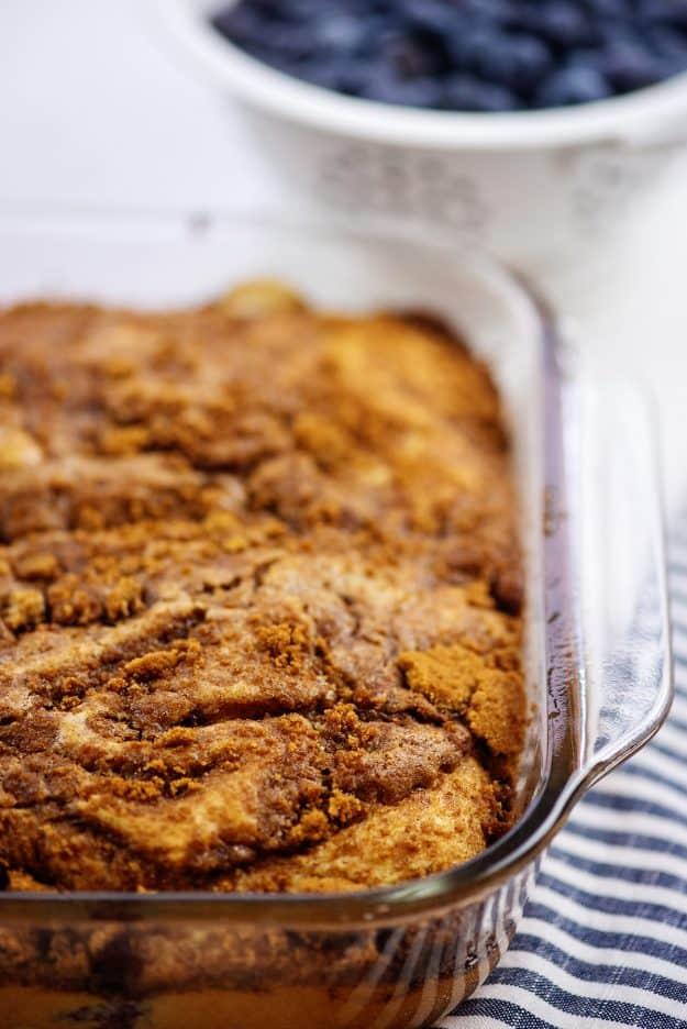 baked cinnamon roll cake in baking dish.