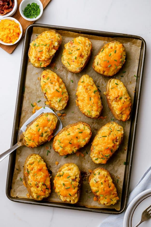 twice baked potatoes on baking sheet.