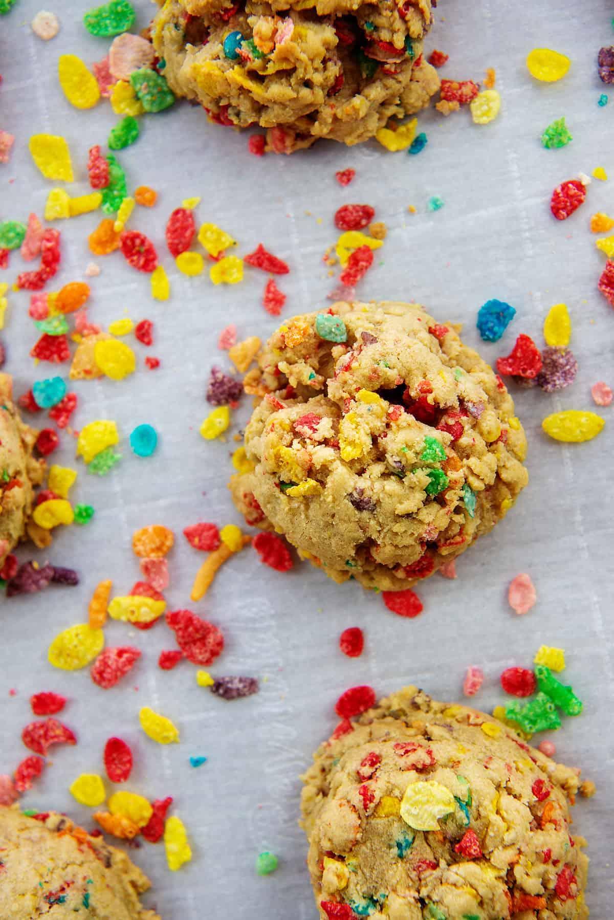 Fruity pebbles cookies on baking sheet.