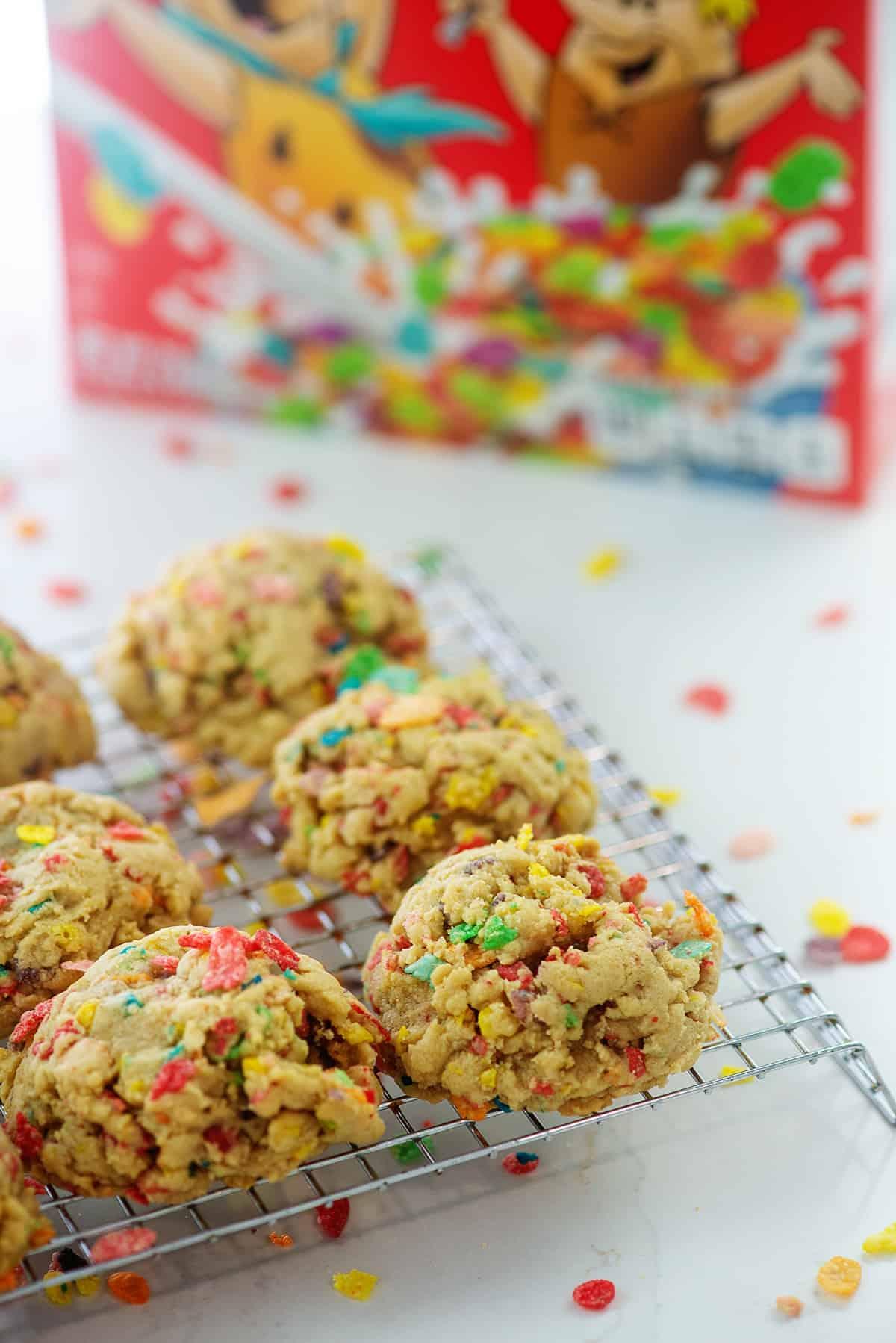 fruity pebbles cookies on cooling rack.