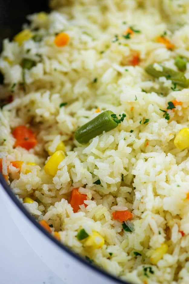 rice with mixed vegetables in white pot.