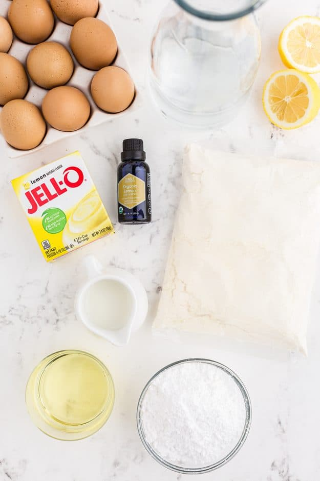 ingredients for lemon bundt cake on white background.