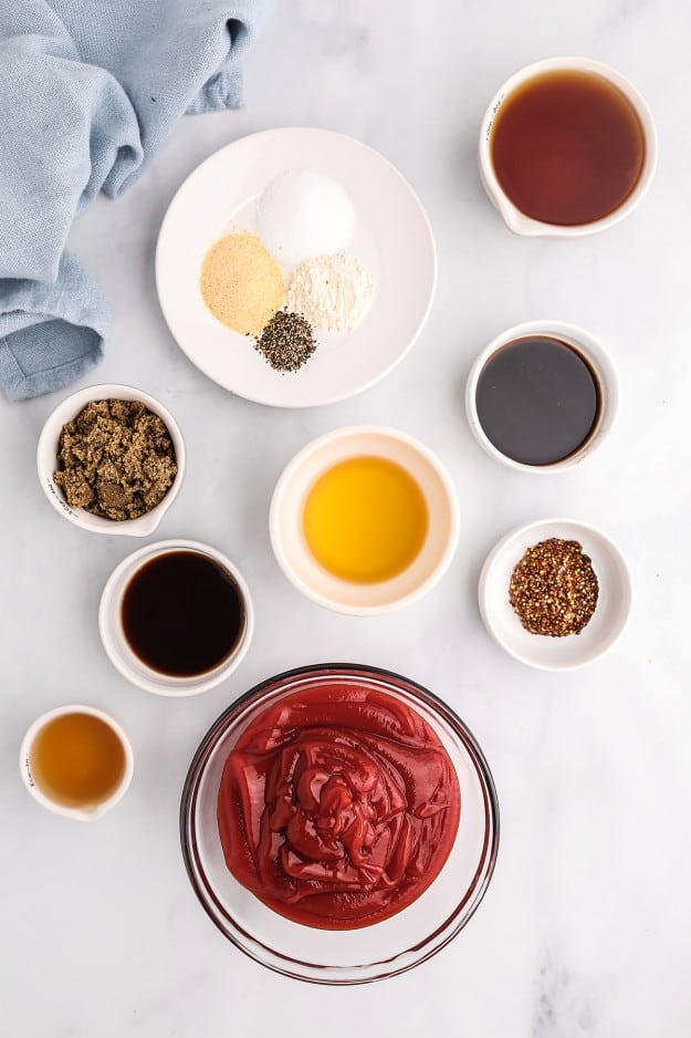 ingredients for bourbon bbq sauce on white counter.