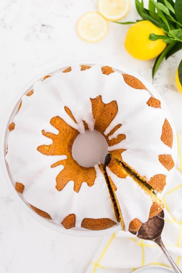 moist lemon bundt cake on cake stand.