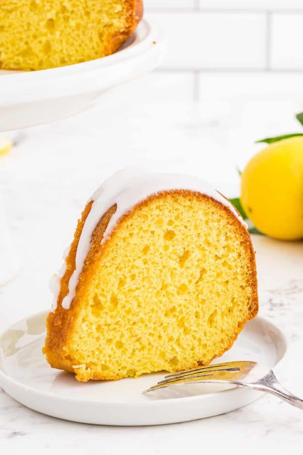 slice of lemon bundt cake on white plate.