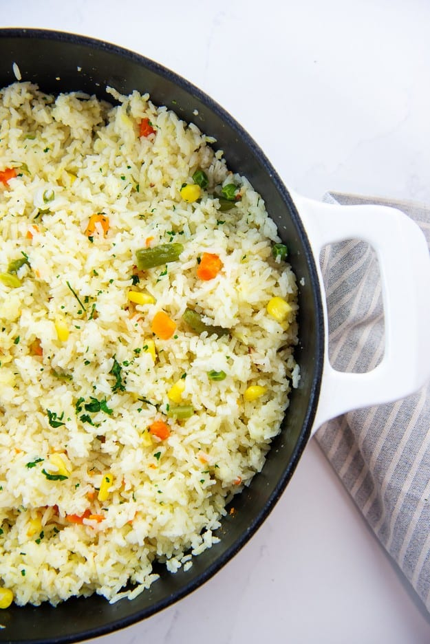 white rice with mixed vegetables in skillet.