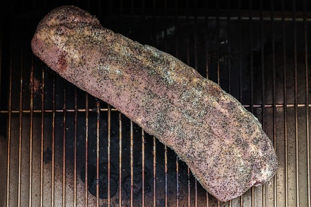 rack of ribs in smoker.
