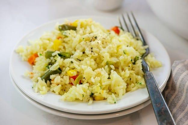 plate full of rice and veggies.