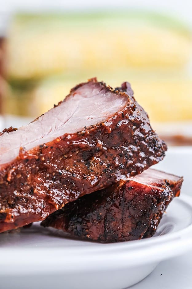 stack of ribs on plate.