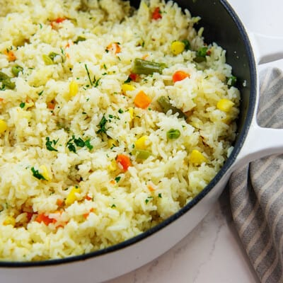 rice with vegetables in white pot.