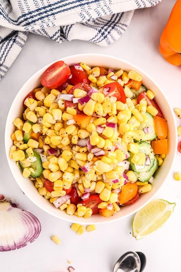 Corn tomato salad in white bowl.