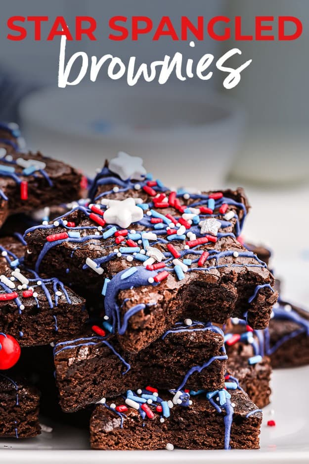 4th of July brownies stacked up on plate with red, white, and blue sprinkles.