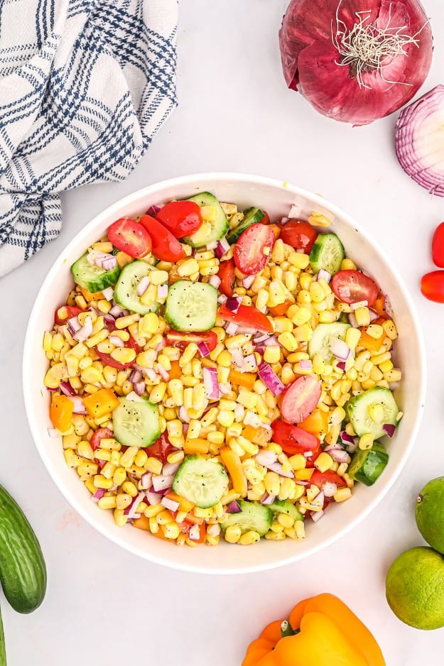 summer corn salad ingredients in white mixing  bowl.