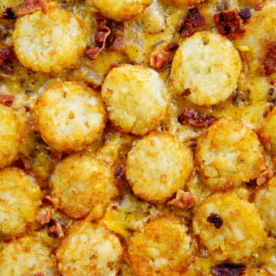 tots layered over cheesy beef.