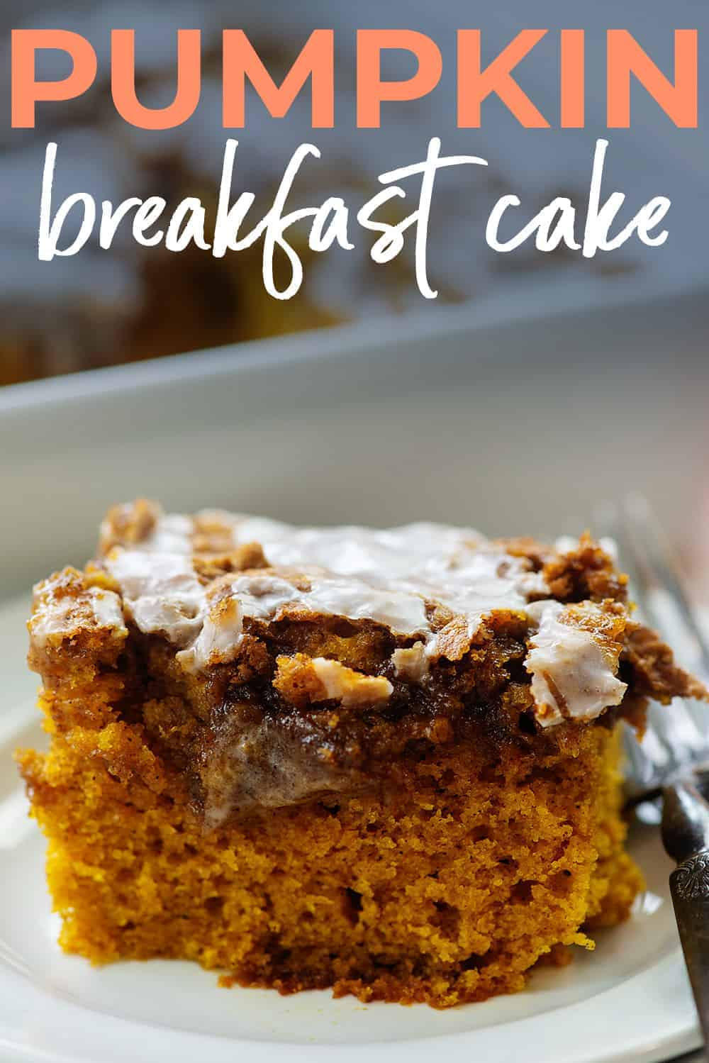 slice of pumpkin cake on white plate with text for Pinterest.