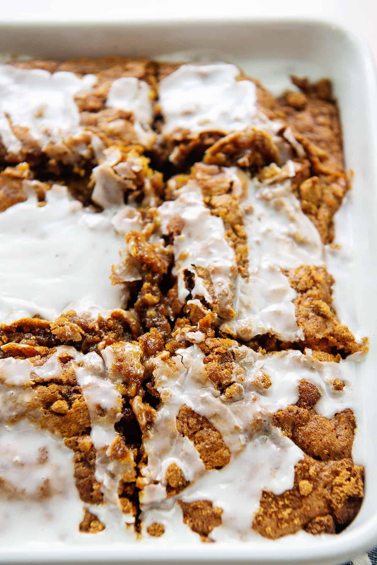 sliced pumpkin breakfast cake in white dish.