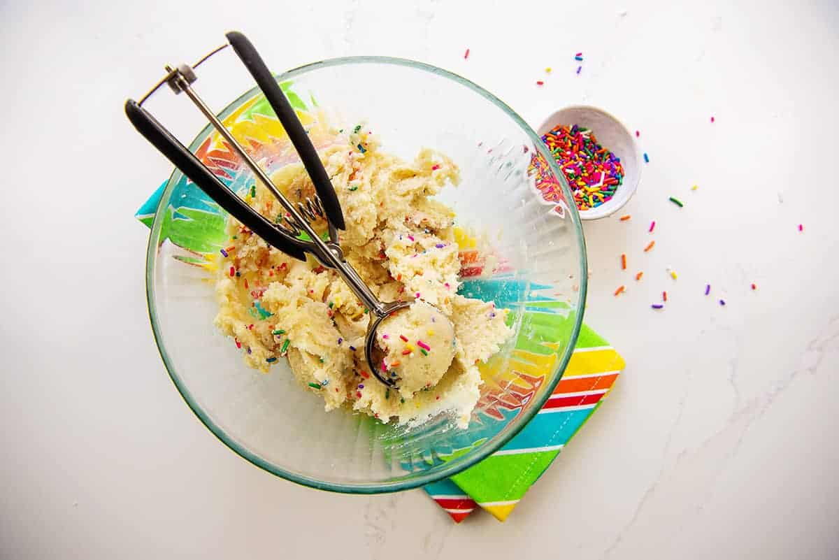 sugar cookie dough in glass mixing bowl.