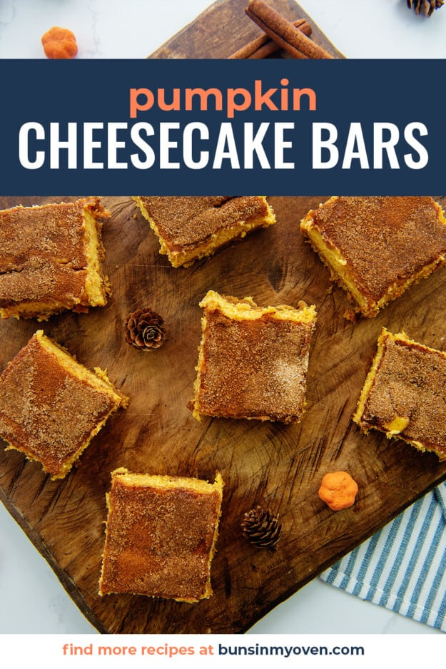 overhead view of cheesecake bars on wooden board.