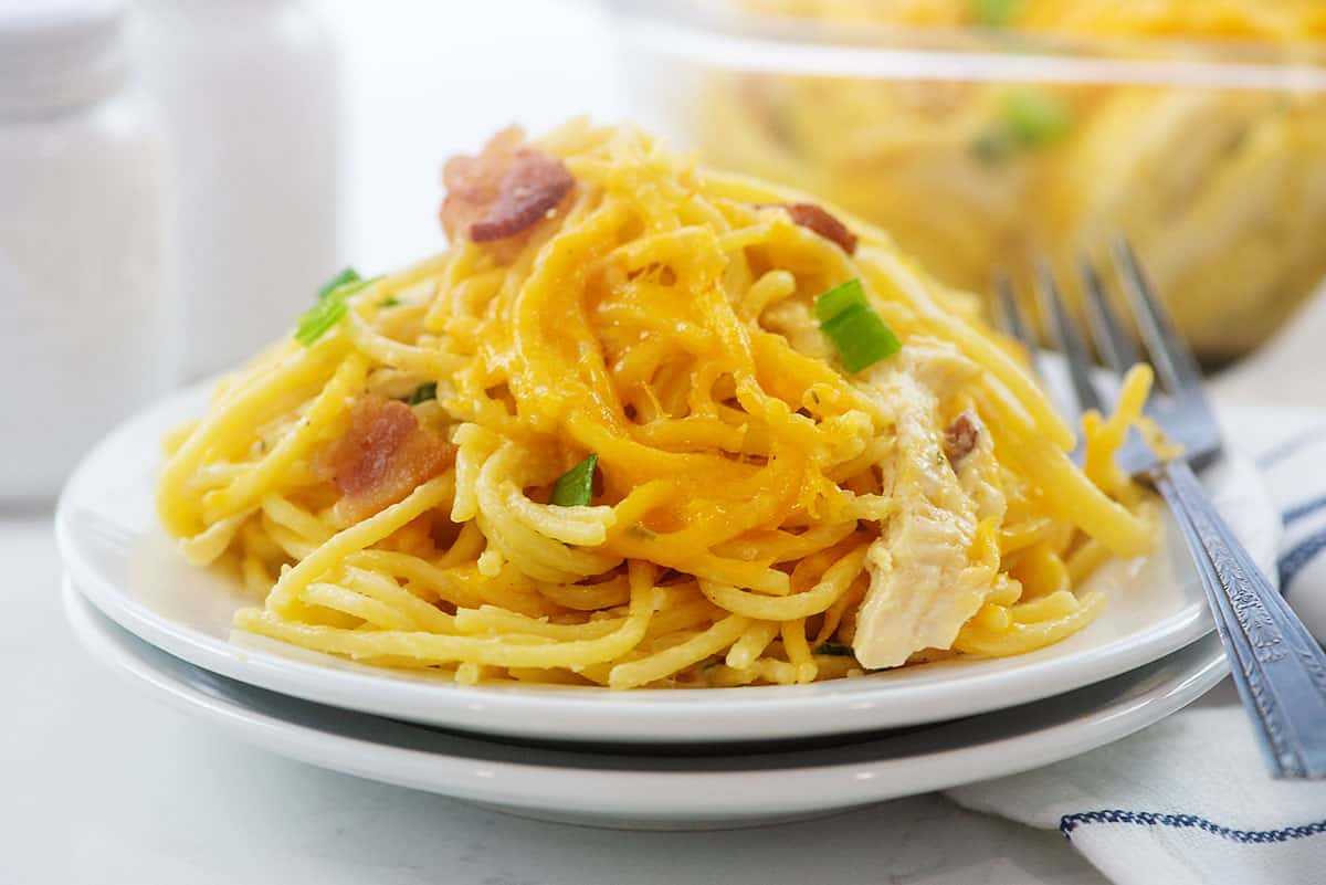 crack chicken spaghetti on white plate.
