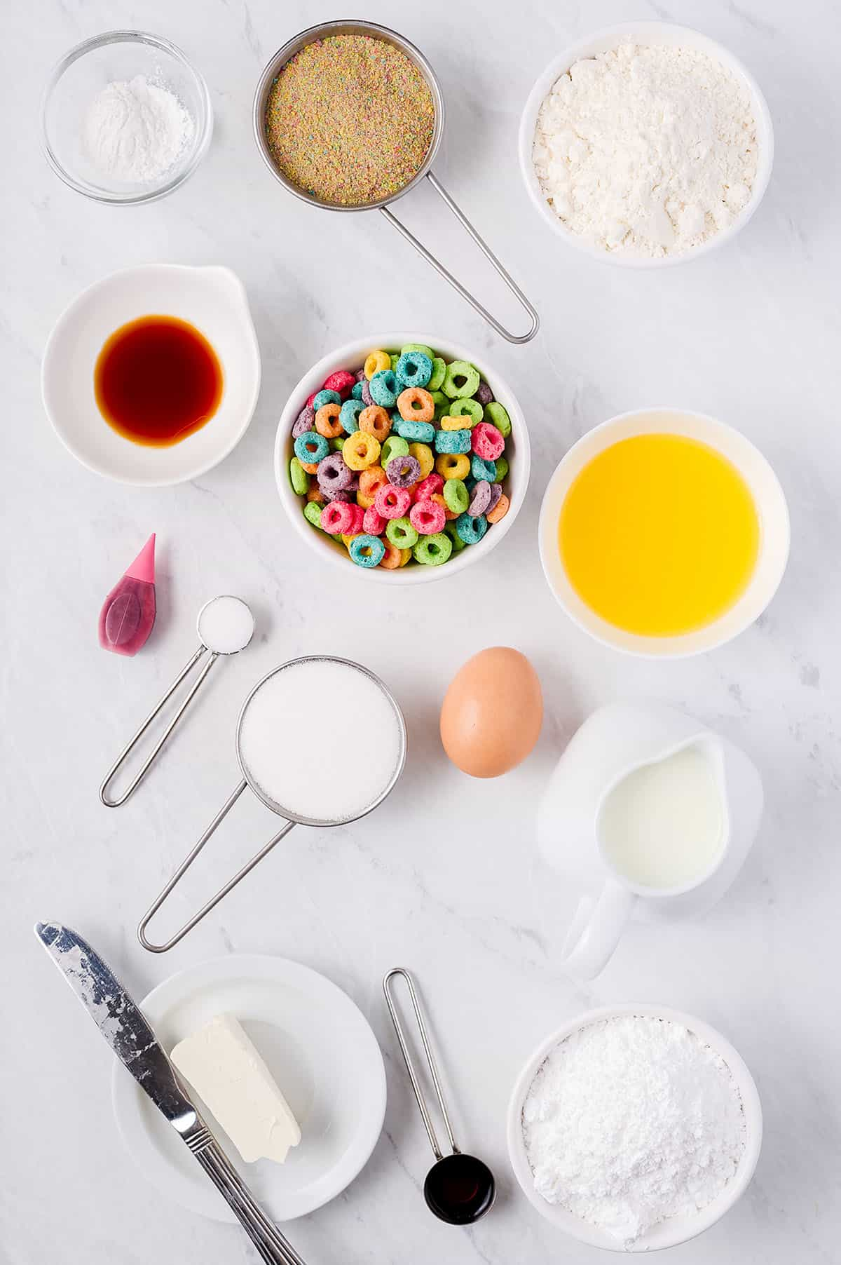 ingredients for Fruit Loop donuts on white counter.