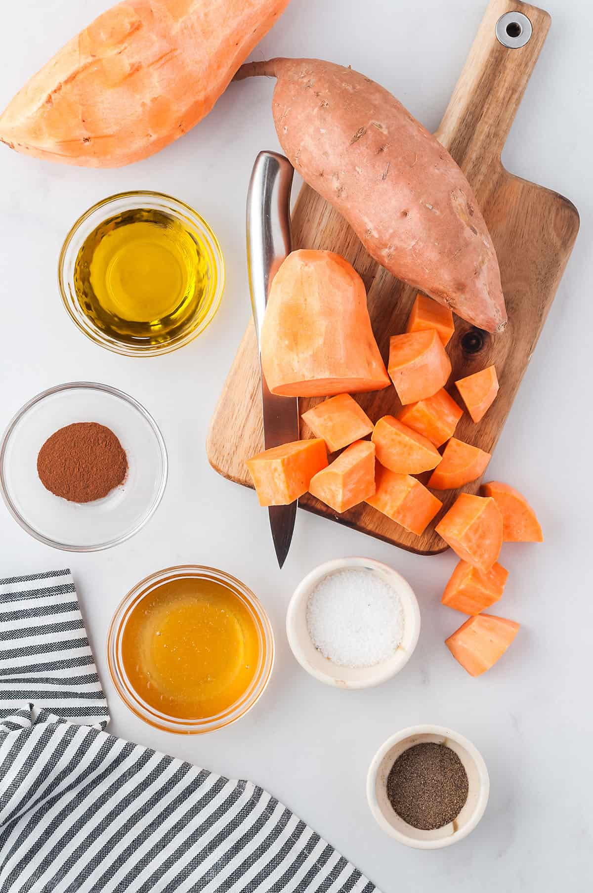 ingredients for roasted sweet potato cubes on board.